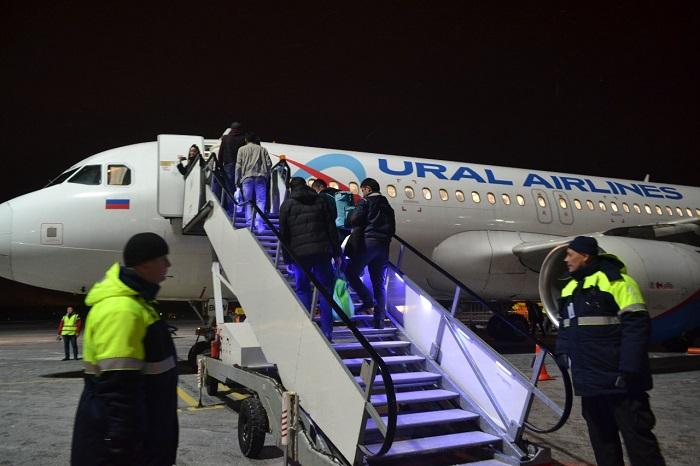 Посадка на борт компании Уральские aвиалинии